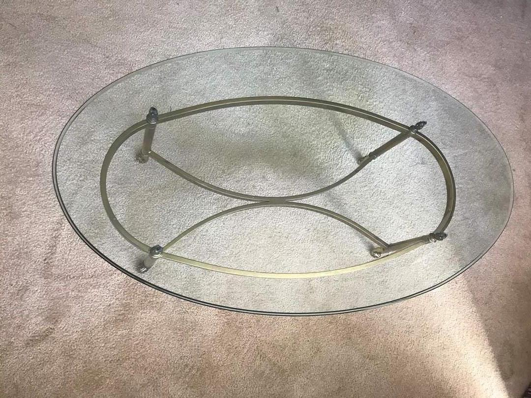 Lot # 16 - Glass Oval Coffee Table with Brass Legs (main image)