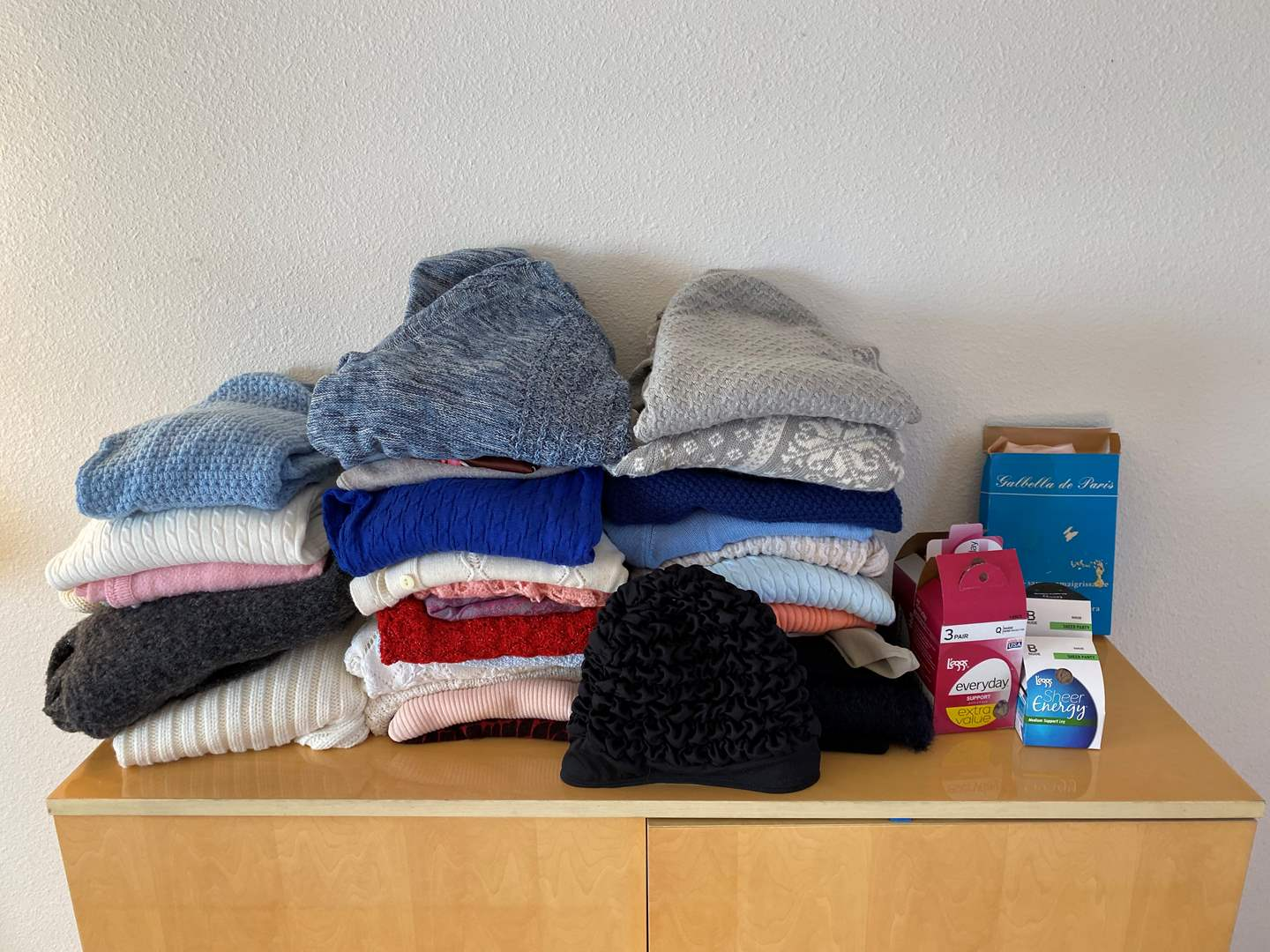 Lot # 25 - Women's Clothing: Sweaters, Nylons, Swim Suit & More (See Pictures).. (main image)