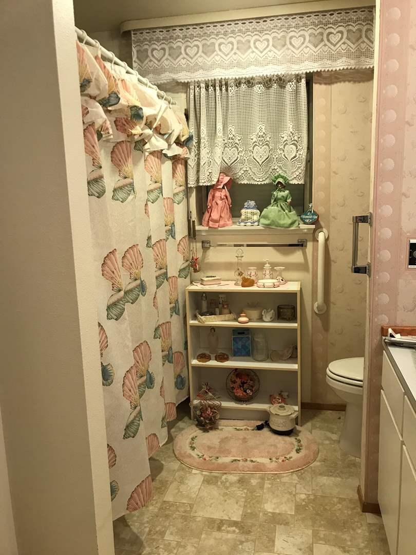 Lot # 121 - Bathroom Decor: Small Shelf, Vintage I.W. Rice Toothbrush Holder, Soap Dish, Vase, Soap Dispenser & More.. (main image)