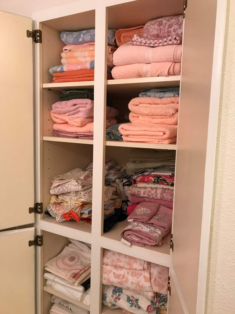 Lot # 122 - Cabinet Full of Towels, Doilies, Rugs & More.. (main image)