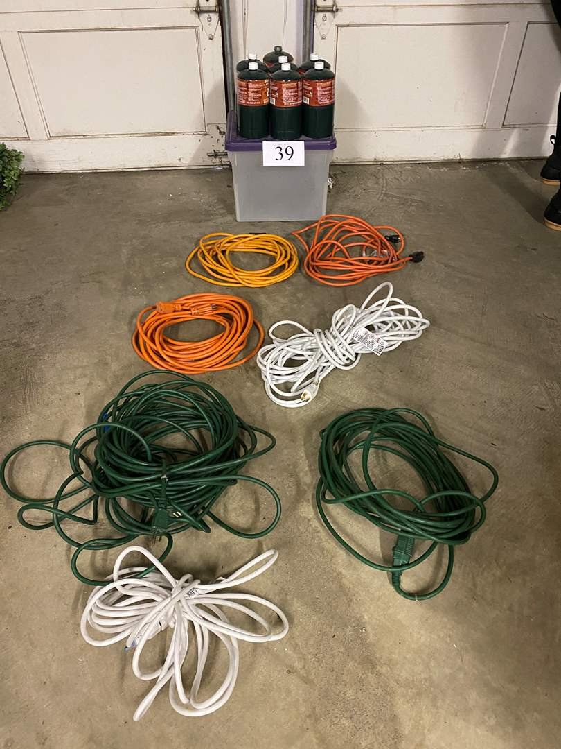 Lot # 39 - 6 New Coleman Propane Canisters, 2 American Flags, 6 Extension Cords  (main image)