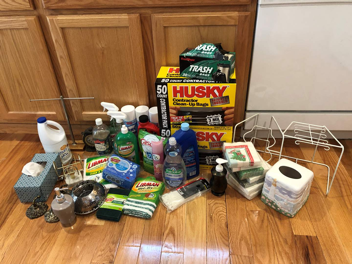Lot # 77 - Some Used & New Cleaning Solutions, New in Box Garbage Bags, Plate & Cup Rack (main image)