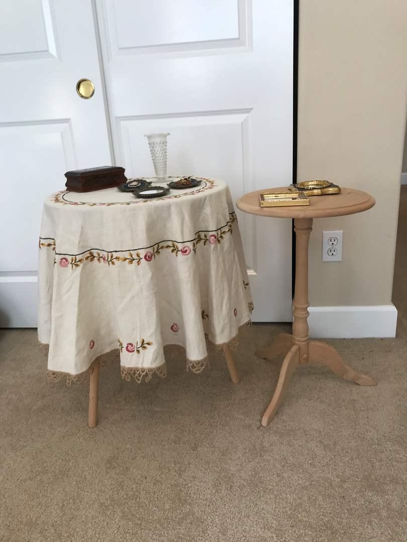 Lot # 97 - Two Small Round Tables, Table Cloth, Wood Keepsake Box, Small Vase & Wall Decor (main image)
