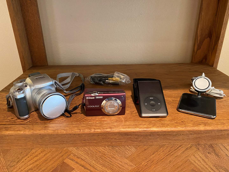 Lot # 121 - Fuji Film S3000 Digital Camera, Nikkon Coolpix s4000 Digital Camera, 80GB Apple iPod w/Case & More.. (main image)