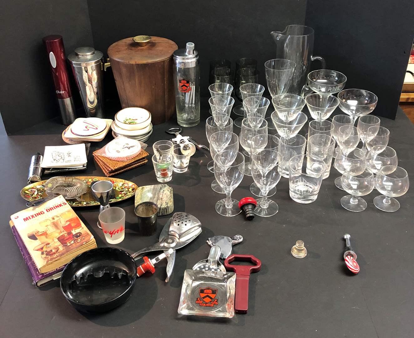 Lot # 63 - Selection of Barware: Stemware, Shakers, Ash Trays, Recipe Books, Shot Glasses & More.. (main image)