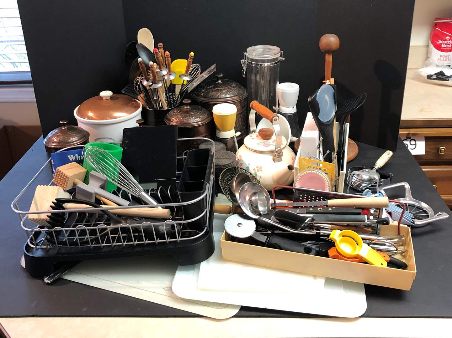 Lot # 72 - Large Selection of Kitchen Items: Wooden Spoons, Scale, Dish Rack, Canisters, Cookie Jar, Kettle & More.. (main image)