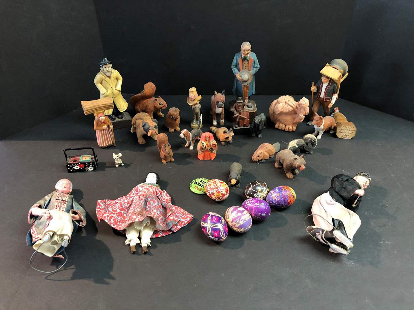 Lot # 187 - Wood Carved Figurines & Painted Eggs (main image)