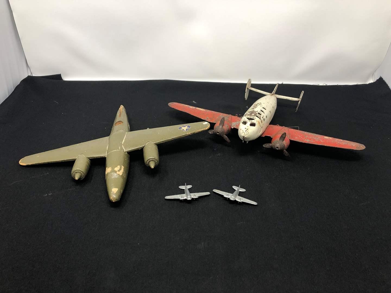 "Lot # 194 - Vintage Metal ""Defense Bomber"" Plane, Vintage Wood Plane & 2 Small Planes (main image)"