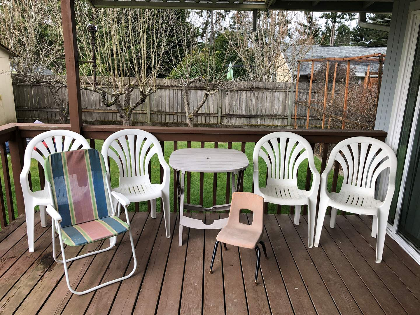 Lot # 244 - Plastic Outdoor Chairs, Outdoor Table, Child's Chair, Folding Beach Chair & Yard Decor (main image)