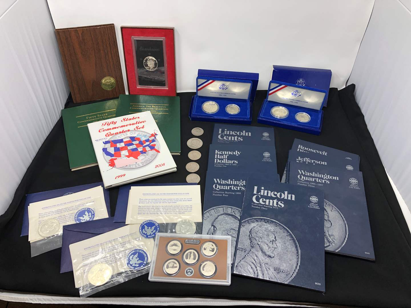 Lot # 238 - Coin Collection Items: Coin Books, Liberty Coins, Uncirculated Eisenhower & More..  (main image)