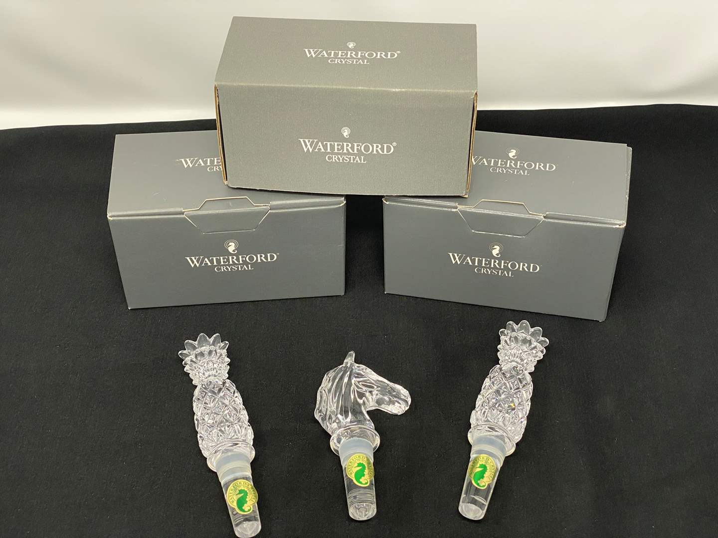 "Lot # 9 - Two ""Waterford"" Crystal Pineapple Stoppers, One ""Waterford"" Horse Stopper w/Boxes (main image)"