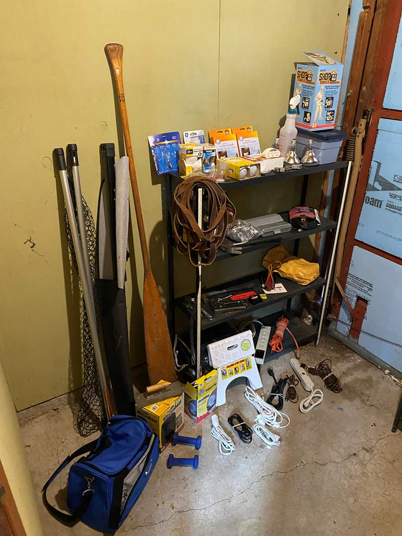 Lot # 234 - Metal Shelf Full of Light Bulbs, Tools, Hardware, Leather Horse Straps, Extension cords, Boat Oar & More..  (main image)