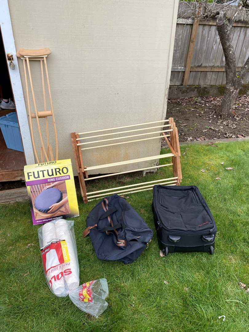 Lot # 248 - Clothes Rack, Crutches, Suit Case & Solo Cups (main image)