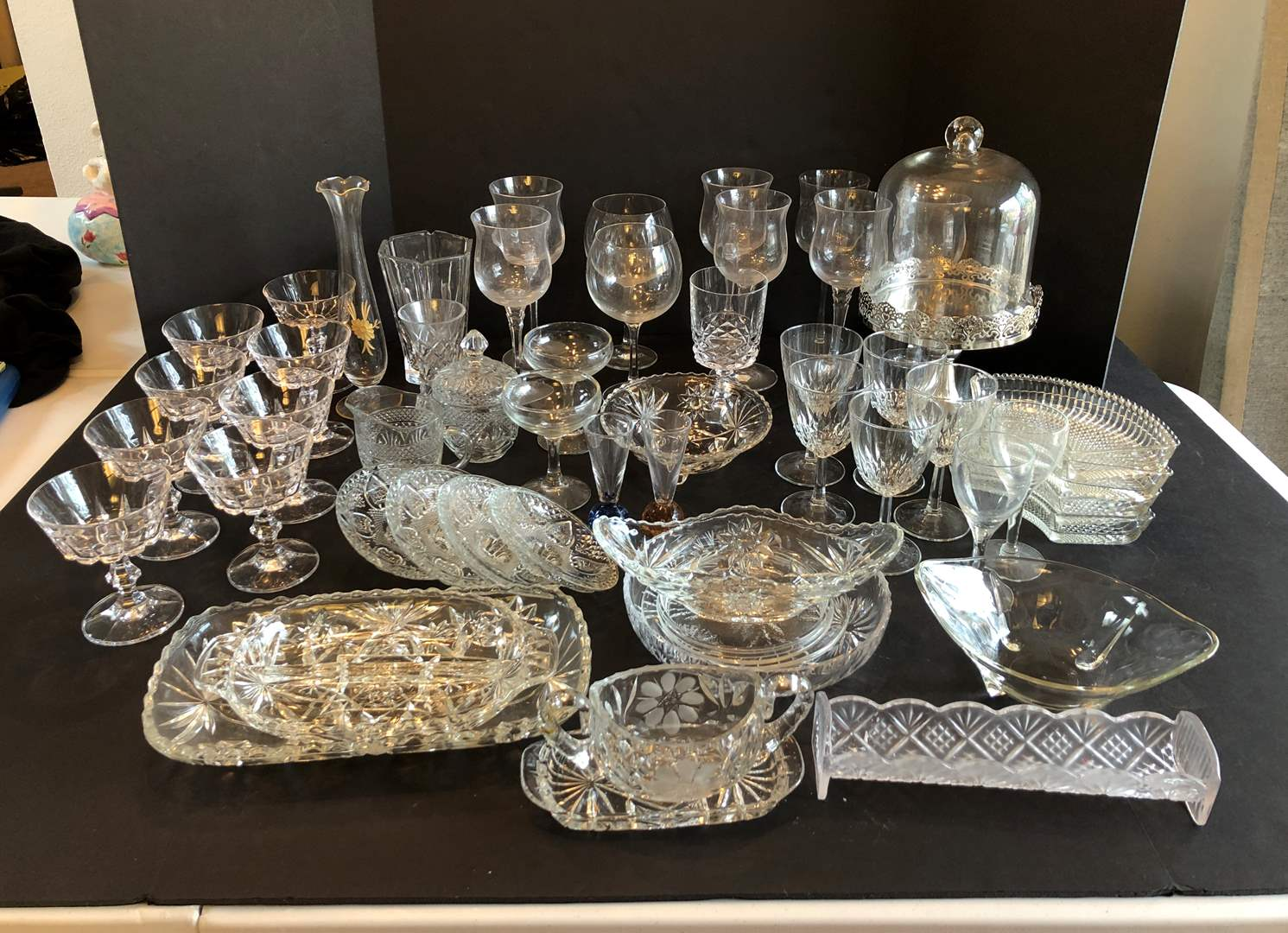 Lot # 125 - Large Selection of Stemware, Crystal Tidbits Trays, Cream & Sugar, Vases, Cake Stand & More..  (main image)