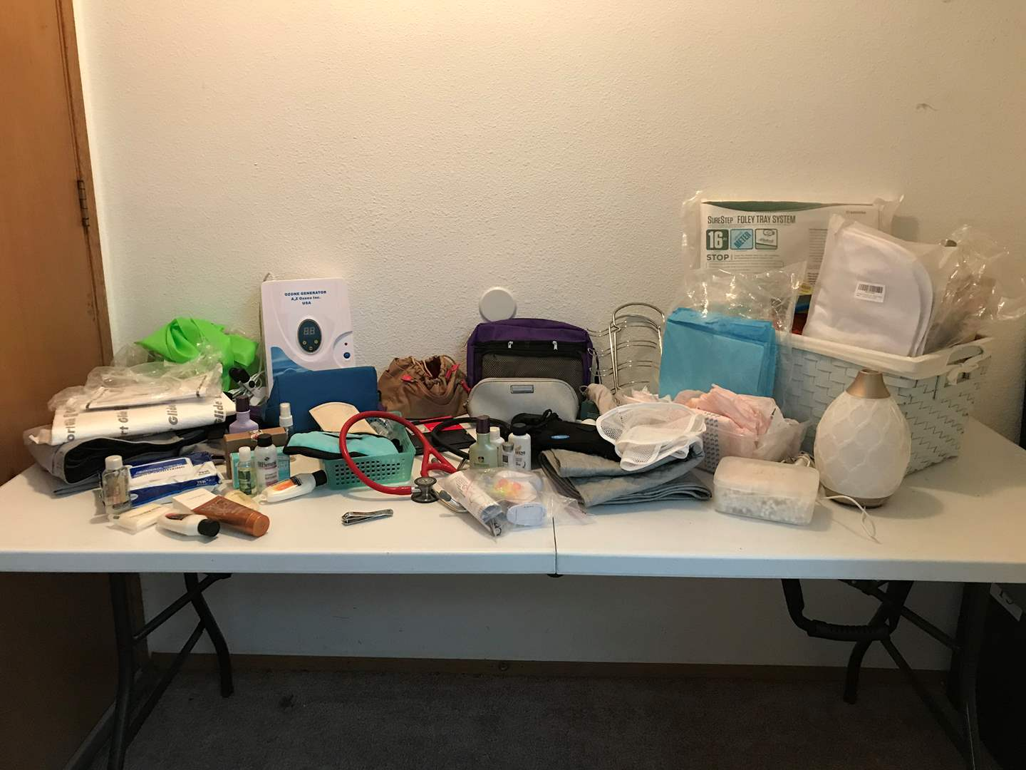 Lot # 223 - Medical & Misc. Items: Comfort Glide Sheet, Ozone Generator, Soaps, Lotions, Pads & More..  (main image)