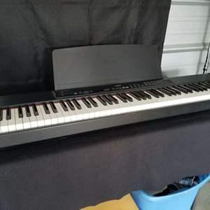 Lot # 10 - Refurbished Yamaha P-90 Professional Portable Stage Electronic Keyboard