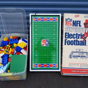 Lot # 16 - Tub of Large Legos and Like New NFL Electric Football Game w/Box (no game pieces)