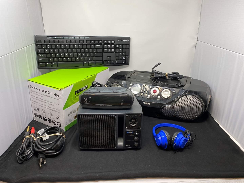 Lot # 45 - Philips Boom Box Stereo, Wireless Keyboard, Printer Toner, Alarm Clock & More..  (main image)