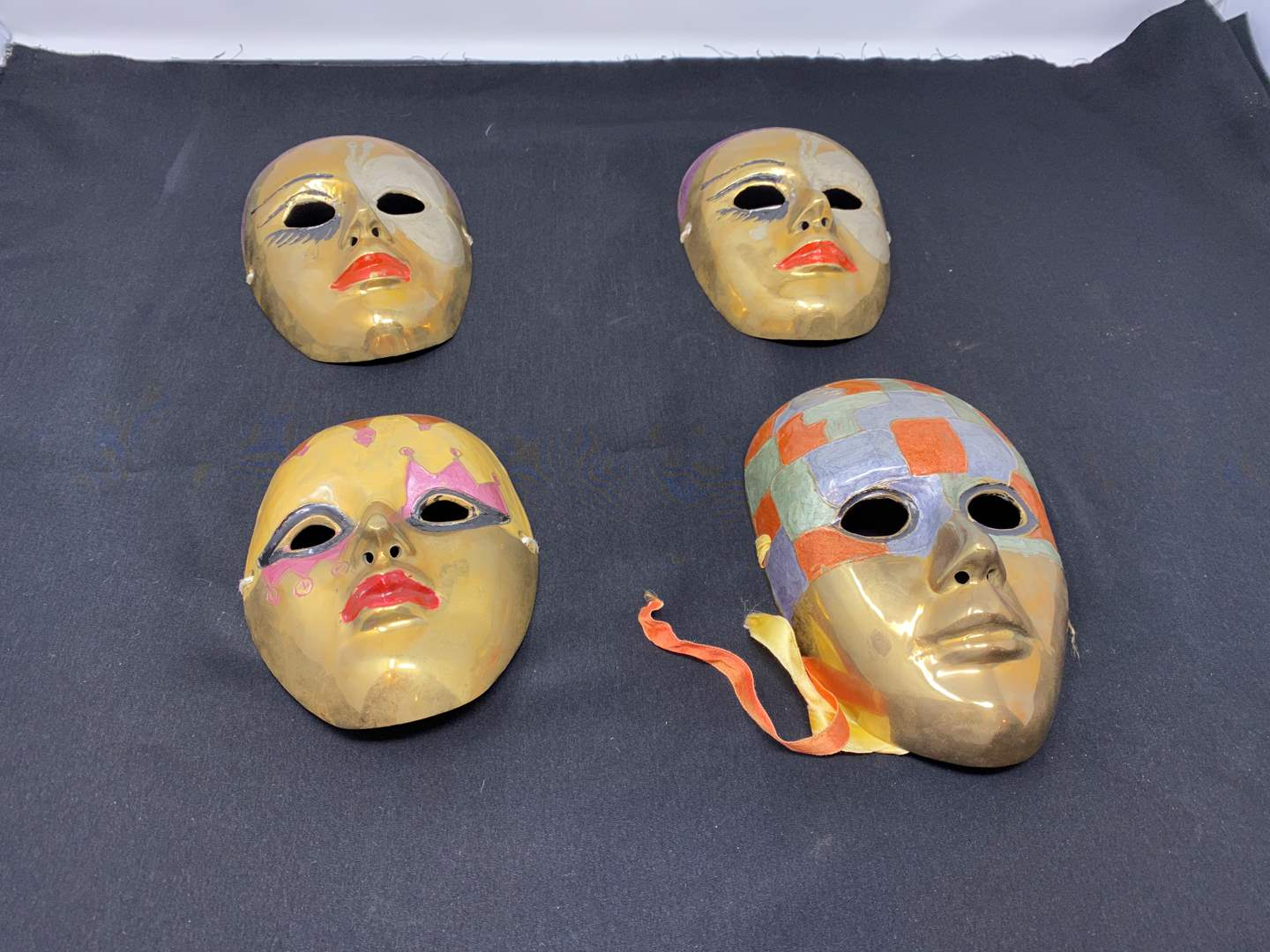 Lot # 46 - Four Solid Brass Masks (main image)