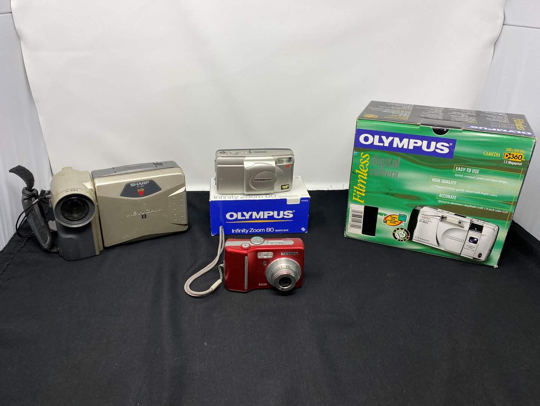 Lot # 47 - Four Cameras  (main image)