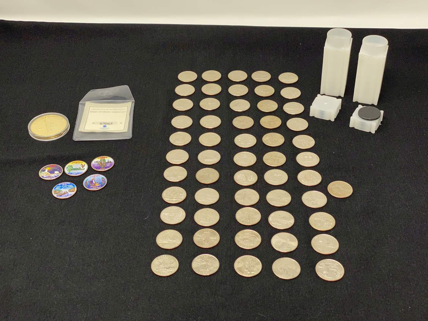 Lot # 81 - Uncirculated 55-State Quarters, Five Colored State Quarters, Statue of Liberty Proof. (main image)