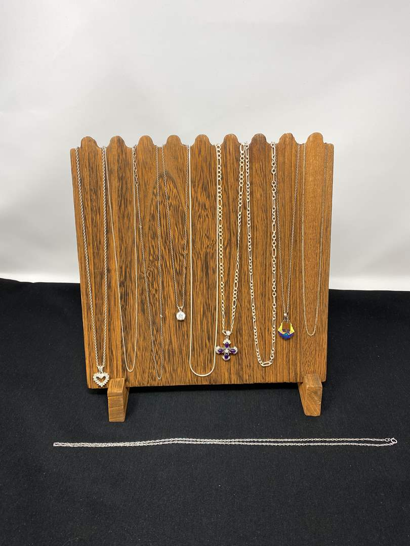 Lot # 123 - Ten Sterling Silver Necklaces of Various Sizes - (Stamped .925 - 59.42 Grams). (main image)