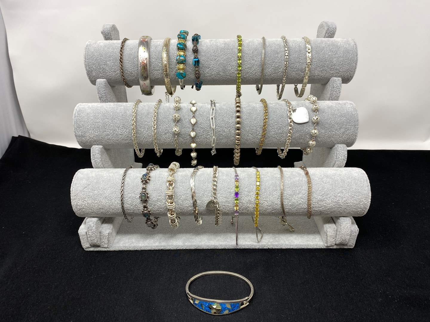Lot # 124 - Twenty-Eight Sterling Silver Bracelets of Various Sizes - (Stamped - .925 - 290 Grams). (main image)