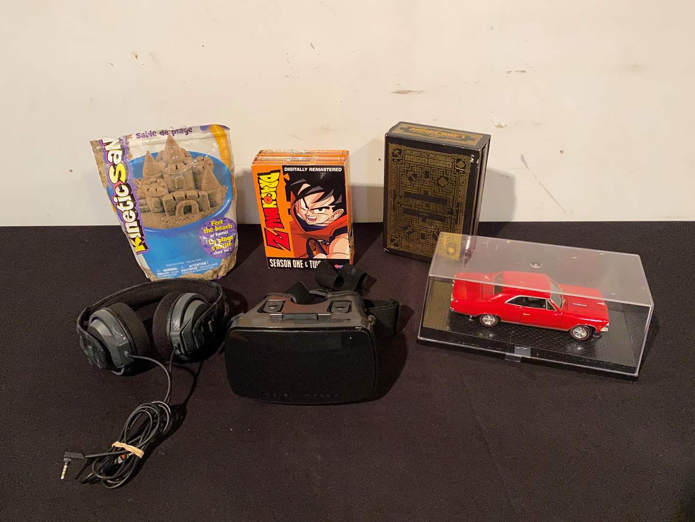 Lot # 155 - Dragon Ball Z 1st & 2nd Season DVD's, Complete Minecraft Handbook, Kinetic Sand, VR Headset, Headphones, Model Car. (main image)