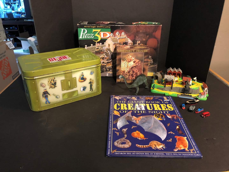 Lot # 170 - Vintage G.I Joe Tin, Puzzles, Small Train Set & Misc. Action Figures (main image)