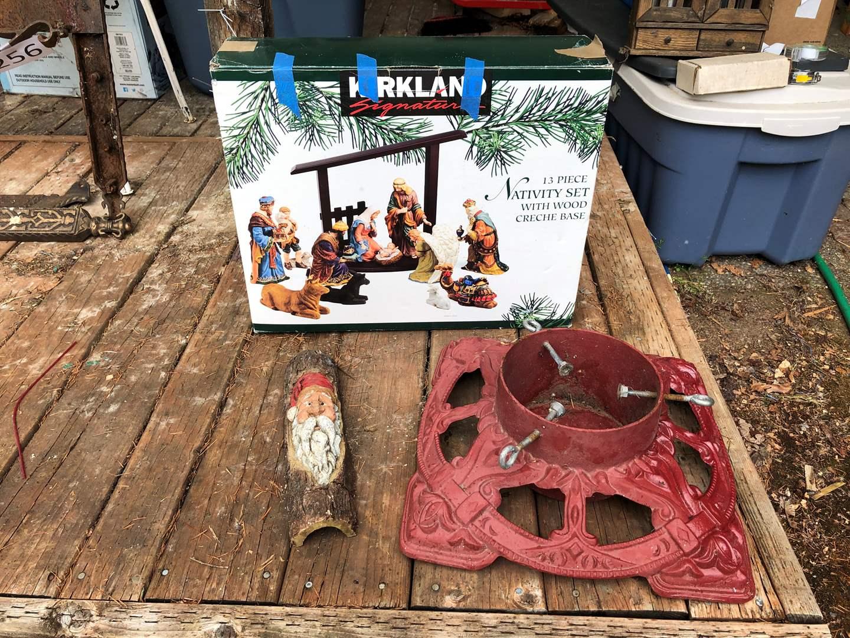 Lot # 257 - Heavy Cast Iron Christmas Tree Stand, Kirkland Signature Nativity Set & Wood Santa Decor (main image)