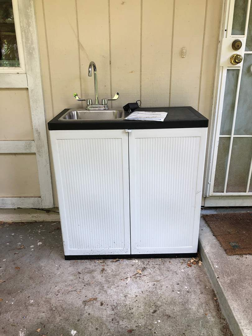 Lot # 261 - Indoor/Outdoor Sink Flojet Bottled Water System 5000 Series, Emax Hot Water Heater (main image)