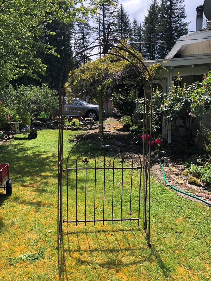 Lot # 262 - Antique Wrought Iron Arch w/ Gate (main image)