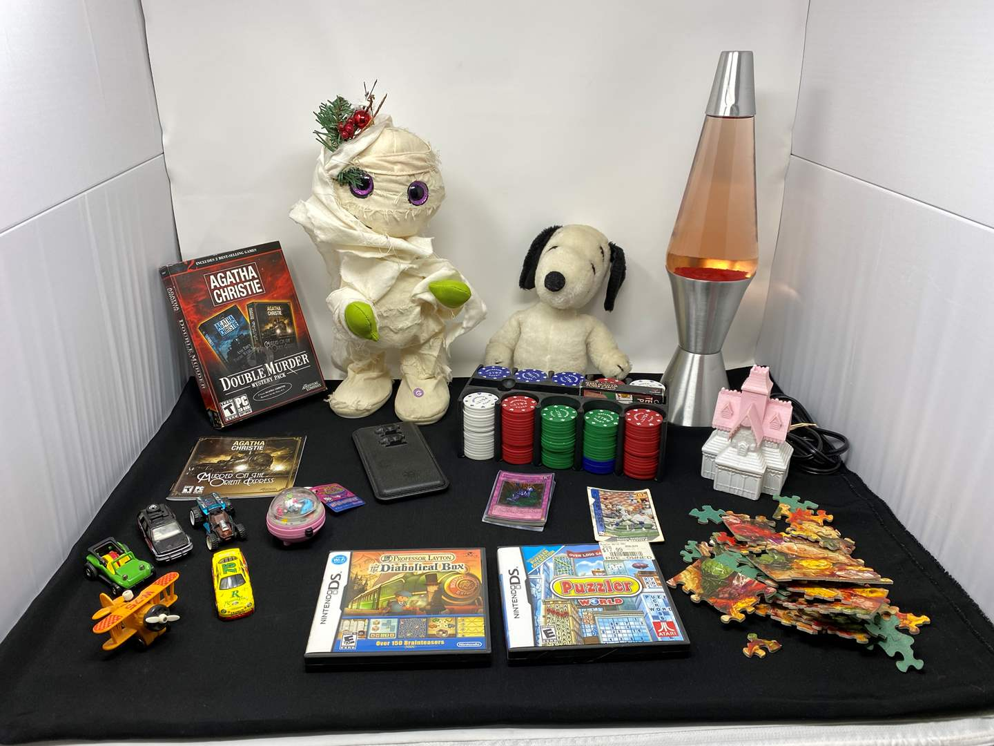 """Lot # 47 - Kid Items: Dancing """"Thriller"""" Mummy Doll, Nintendo DS Games, Poker Chips, Puzzle & More..  (main image)"""