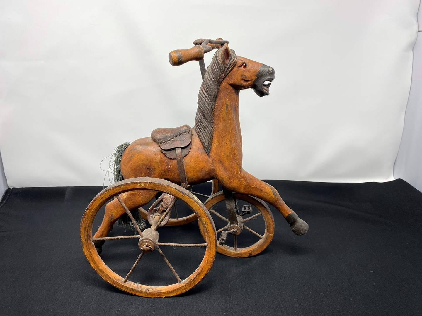 Lot # 100 - Antique Handmade Small Wood Horse Tricycle w/ Leather Seat (main image)