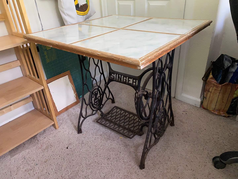 Lot # 211 - Antique Cast Iron Singer Treadle Sewing Machine Base w/Tile Table Top (main image)