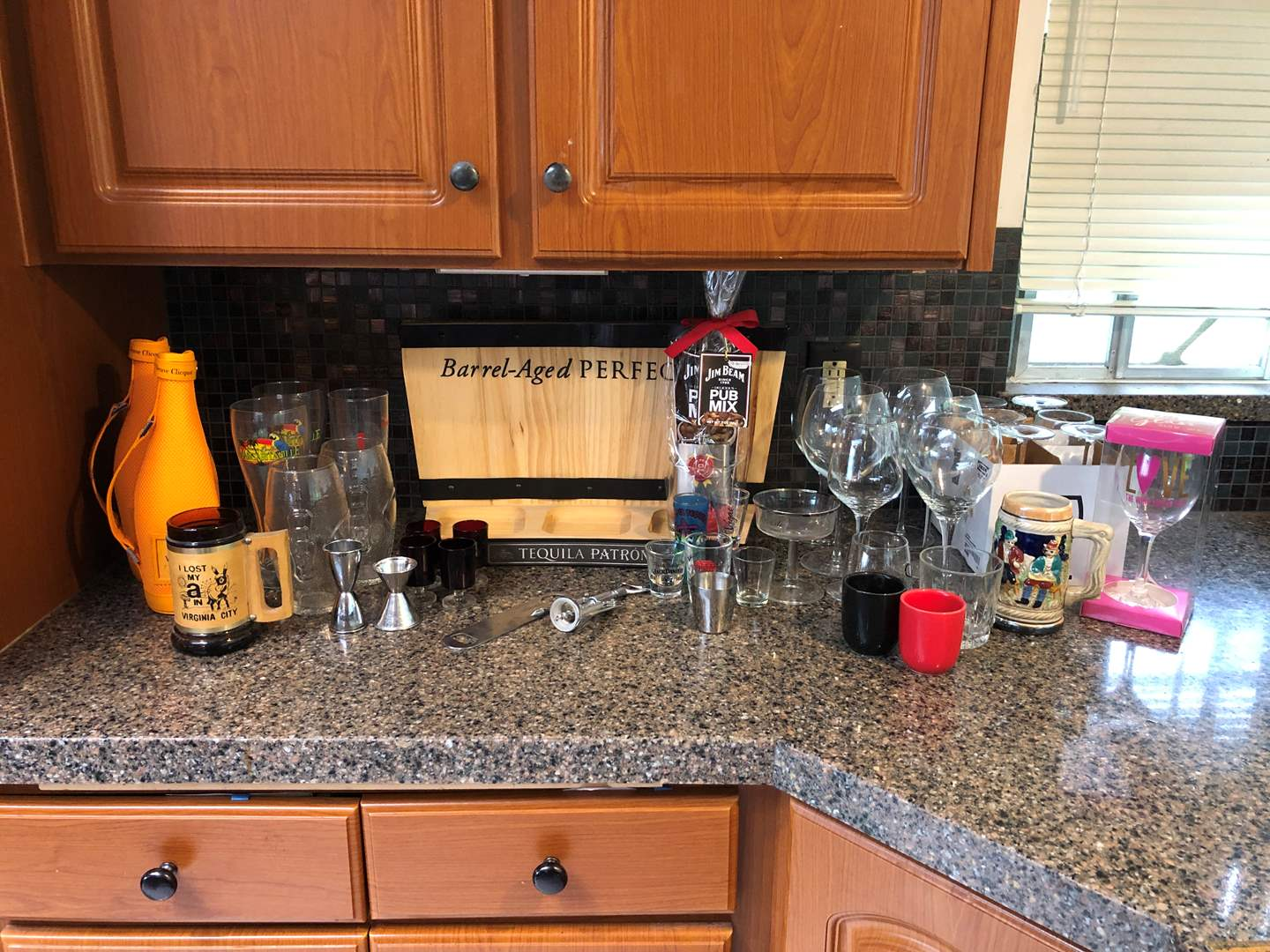 Lot # 63 - Selection of Barware: Wood Patron Bottle Stand, Wine Glasses, Shot Glasses & More..  (main image)
