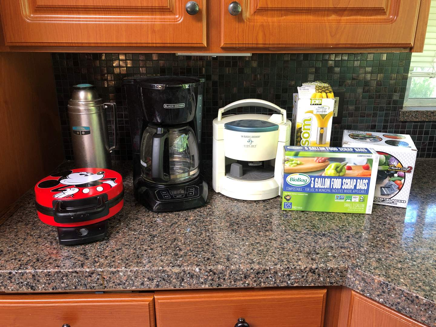 Lot # 138 - Black & Decker Coffee Maker, Mickey Mouse Waffle Maker, Chefs Rival 9 Attachments & More..  (main image)