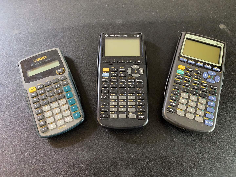 Lot # 23 - Three Texas Instruments Scientific Calculator  (main image)