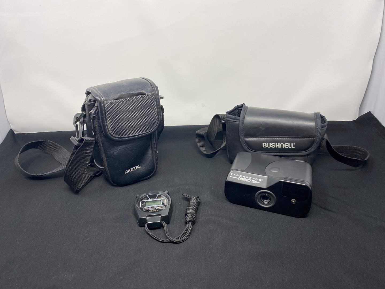 Lot # 24 - Bushnell Yardage Pro Compact 600 Rangefinder, Stop Watch & Digital Camera Case (main image)