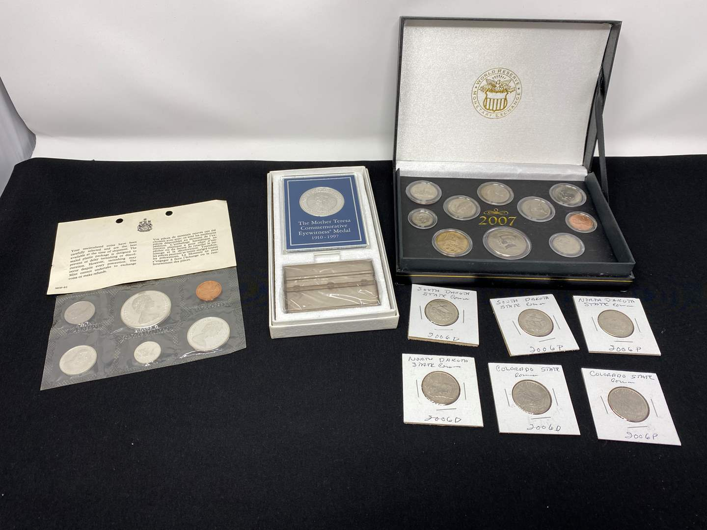 Lot # 205 - Uncirculated Foreign Coins, Uncirculated 2007 Coins, Uncirculated 2006 State Quarters & Mother Teresa .999 Silver Co (main image)