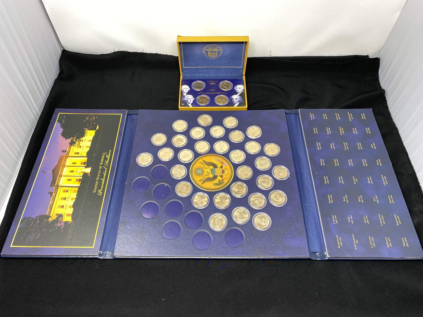 Lot # 213 - 34 Gold Toned Presidential $1.00 Coins (main image)