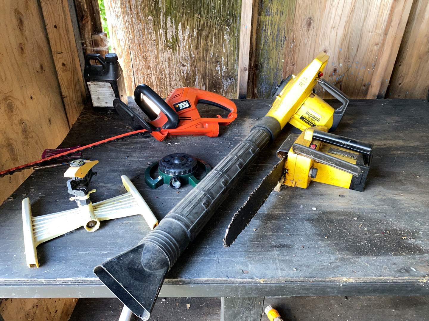 Lot # 235 - Black & Decker Trimmers, Leaf Blower, Chain Saw & More..  (main image)