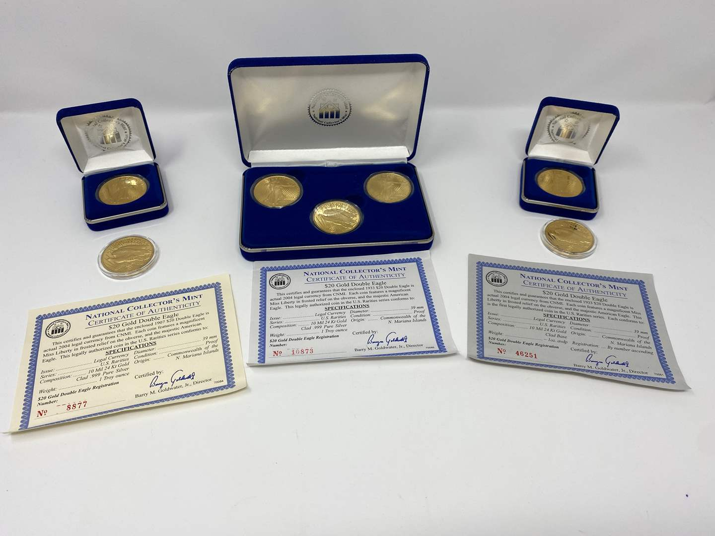 Lot # 254 - Seven 10 Mil 24kt Gold Clad, .999 Pure Silver One Troy Ounce, $20.00 Gold Double Eagles (main image)