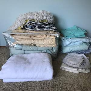 Lot # 54 - Down Comforter, Sheet Sets, 2 Towels, Table Cloth, Two Pillow Shams, Baby Blanket & More..