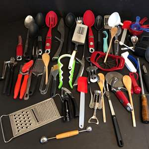 Lot # 60 - Large Lot of Kitchen Implements: Spatulas, Plastic & Wood Spoons, Can Openers, Measuring Cups & More..