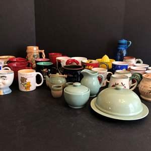 Lot # 72 - Coffee Mugs, JCP Cream, Sugar & Butter Dish Set, Enamelware Mug, Juicer & More..