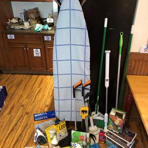 Lot # 168 - Ironing Board, Brooms, Lightbulbs, Brita Water Filters, Grabber Tools, Electric Toilet Scrubber, Swiffer Pads & More