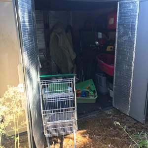 Lot # 433 - Shed Full of Garden Items: Trash Bin, Gas Cans, Hedge Trimmer, Shopping Cart & More