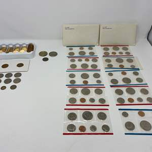 Lot # 48 - Eighty-Five Sacajawea Dollars, 7 Susan b. Anthony, 10 Sets of Uncirculated Coins & More.