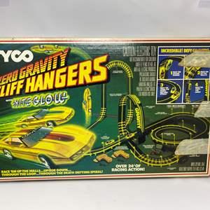 Lot # 220 - Vintage Tyco Zero Gravity Cliff Hangers with Nite Glow Slot Car Track